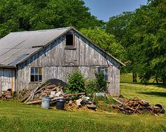 This old shed was spotted on Swisher Road in Champaign County, Ohio. This owner is renovated his property, slowly but surely. He started with the farmhouse, and it is beautiful. He has no plans to tear anything down, but to fix it up. Behind his property is a large field that has been sold to a wind farm company, he isn't happy about that. He wanted to buy the field, but they outbid him.