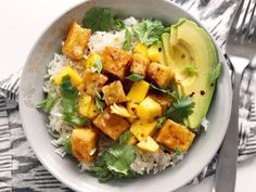 Mango Coconut Tofu Bowls with savory coconut rice, honey-lime glaze, avocado, sweet mango, and spicy red pepper. Step by step photos.