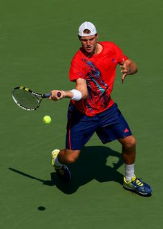 Jack Sock of the United States returns a shot against Nicolas Almagro of Spain during their men's singles third round match on Day Six of the 2012 US Open