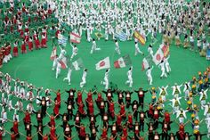 Performers carry flags of the participant countries during the opening ceremony of the 2013 Confederations Cup at the National Stadium in Brasilia, Brazil, Saturday, June 15, 2013