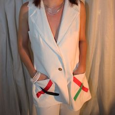 Vintage 70's Vest and Pants Suit Check out this amazing pants suit!  This was worn once in a fashion show in the 70's and it has been in storage ever since!  Beautiful condition! White with embellishments on the pockets. Designer tags have been obliterated since it was used in a fashion show - sadly I don't know the designer. The tag left in the pants indicates a size 8 but it's a vintage size 8. The model in the photo is a size 2 in current sizes.  Vest is lined with same material as…