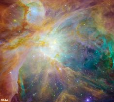 Chaos in Orion: Baby stars are creating chaos 1,500 light-years away in a cosmic cloud called the Orion nebula. Four massive stars make up the bright yellow area in the center of this false-color image from NASA's Spitzer and Hubble Space Telescopes.