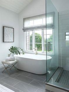 Clean, modern bathroom with sweet inspirational canvas print on the wall #bathroomideas #BathroomRemodeling