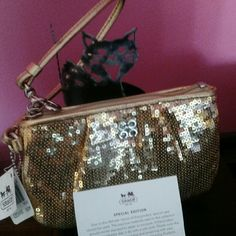 """Gorgeous Authentic NWT Coach Gold Sequin Wristlet Gorgeous Gold Sequin Wristlet With Tags Still On. Never Used! Super Sparkly! This Wristlet Will Be Perfect For Summer! Size is 6 1/2"""" (L) X 4 1/2"""" (W). Strap Length Is 6"""" (L). Don't Miss Out On This Great Price! Check out my other listings! Discounts Available When Purchasing Multiple Items! Fast Shipping! Coach Bags Clutches & Wristlets"""