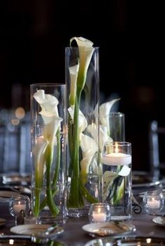 Calla lily centrepiece, different size vases and floating candles.