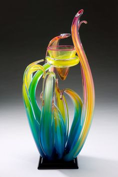 RANDY STRONG - Hawaiin Blue: Orchid Series...Creating high quality glass work that has been capturing the imagination of galleries, collectors and museums since 1970. Randy Strong has dedicated his life to pushing the limits of hot glass and developing a style that cannot be found anywhere else.