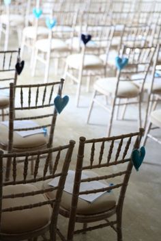 Cute, easy hearts for your ceremony chairs! Easy to DIY. | photo: haywood jones photography. | http://emmalinebride.com/planning/heart-wedding-ideas/
