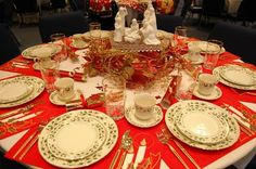 This is my Christmas China, so now I have an idea how to use it!! lots of good ideas for decorating tables.