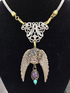 Artist Peter Andrews designs unusual steam punk jewelry....come by OVA arts and take a look!!!