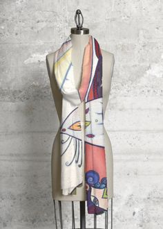 This scarf made with soft, luxurious fabric will add a bold, modern statement to…