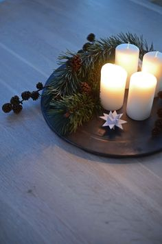 ADVENT - The simplest Advent candle ring. Seen in Home by linn.  It could also be done in the traditional advent wreath colors and sold as a kit.