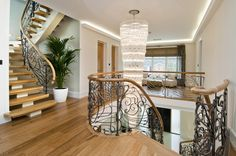 First floor landing, teardrop glass chandelier and bespoke forged staircase