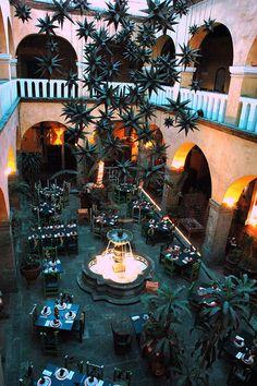 Metal stars, and central Fleur-de-lis fountain, La Fonda de San Miguel Arcangel, (The Fountain of Michael the Archangel), a fine restaurant, Guadalajara, Mexico, via Flickr.