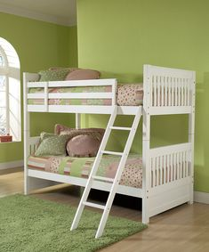 Inspire the imagination with this darling bunk bed that's whimsical yet timeless. Crafted from wood with a neat white finish, this bed goes with a variety of décor schemes, and the ladder makes top bunk access as easy as 1-2-3!