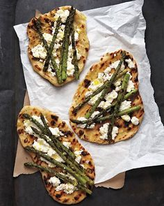 Grilled Asparagus and Ricotta Pizza -  Lightly char rounds of homemade pizza dough, and then top with creamy ricotta cheese, lemon zest, and grilled asparagus. Simmer garlic and rosemary in extra-virgin olive oil to make the fragrant, infused oil for brushing the dough.