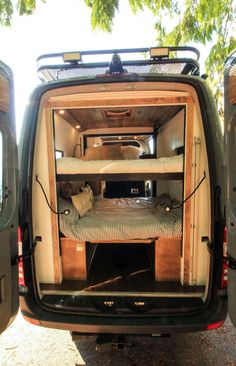 """The Family Van Conversion - Freedom Vans : The Family Van Conversion - Freedom Vans """"The Family Van"""", a Sprinter 144 built for a family of five has an electronic bunk bed, a kitchen galley, and seating for the whole family. Van Conversion Interior, Camper Van Conversion Diy, Van Interior, Ford Transit Camper Conversion, Van Conversion With Bunk Beds, Van Conversion For Family, Motorhome Interior, Motorhome Sprinter, Motorhomes"""