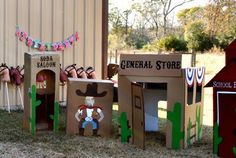 Cardboard box village decorations. Toy Story or western birthday party theme for a cowboy or cowgirl.