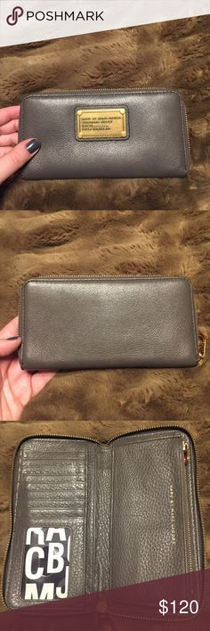 Marc Jacobs Gray Wallet Perfect condition! Soft leather gray wallet with gold hardware. Marc Jacobs Bags Wallets