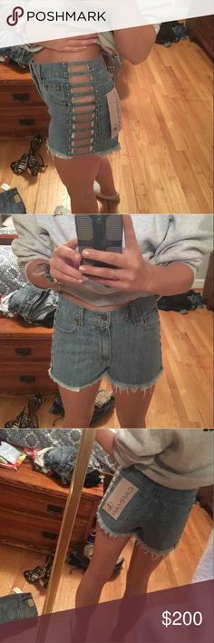 Carmar(from LF) high waisted jean shorts w/cutout High waisted jean shorts with cutouts on the side from LF the brand is carmar they are a size 27 and are brand new with tags LF Shorts Jean Shorts