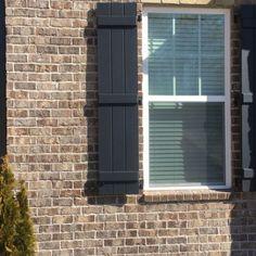 Marshton Queen Brick by Pine Hall Brick with Dark Brown Shutters. Mortar is standard gray.