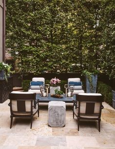 A stylish seating area can turn your yard into an elegant oasis for entertaining | archdigest.com