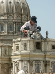 It is nearly impossible to judge the scales of WonderWorks Miniatures without a human scale reference.  This is St. Peter's Basilica as a local technician aids in construction.