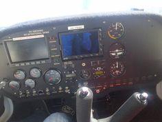 Inside the cockpit of a microlight plane