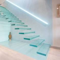 WOW!! A single-flight cantilever staircase crafted in toughened, laminated glass: modern Corridor, hallway & stairs by Railing London Ltd