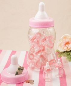 Perfectly Plain Collection Giant blue pink bottle bank container - Our bottle is both a money bank and a container for 16 smaller baby bottles. They all feature clear plastic bottoms with a pink screw cover and white nipple tops. The large bottle has a screw top with a slit to allow change or dollars to be inserted. http://www.favorfavorbaby.com/p-6787.htm