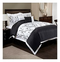 This would complement the tree curtains from IKEA that I like.  ** Tree Branch 6-pc. Black and White Comforter Set by Lush Decor