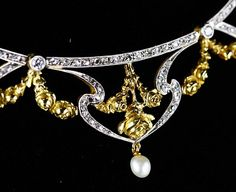 Detail of an art nouveau diamond, pearl and gold necklace.