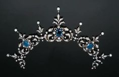 A tiara that is shown off of its frame, for wear as a necklace with additional fittings.