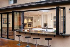 Open-kitchen-with-bar-and-bar-stools-outside ...