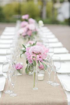 stunning tablescape decked out in pink blooms  Photography By / http://joielala.com