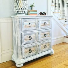 This piece is made by Hooker Furniture Co. It's painted in a beachy...