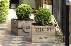 Front door idea I have these crates but again I m a faunaciadal maniac around flants Front Door Planters, Wooden Planters, Front Door Decor, Entryway Decor, Personalized Housewarming Gifts, Beautiful Front Doors, Apple Crates, Square Planters, Front Steps