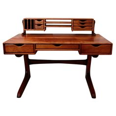 Dale Holub Two-tiered Studio Dovetail Desk  USA  1976  Handcrafted two-tiered studio dovetail desk in koa wood by California Craftsman Dale Holub. Signed 7605.  Price  $8,500