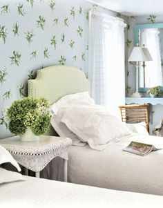 Breezy Bedroom  Sprigs of lily of the valley float across the vintage-inspired wallpaper and are enhanced by a burst of greenery on a light and airy wicker side table. A refreshing yet understated lime green check outlined in a self-welt enhances the graceful silhouette of the custom-upholstered headboard.    Read more: Beach House Decorating - Beach Home Decor - Country Living