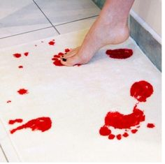 A Bath Mat That Turns Red When Stepped On. Genius.