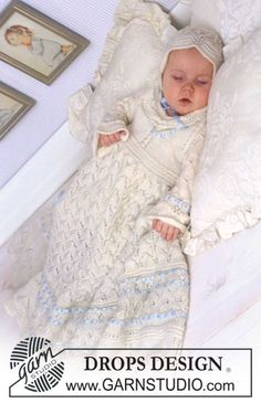 The set comprises: Christening gown, bonnet and jump suit.