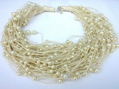 Ivory Linen necklace with light ivory pearls.