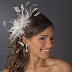 Extravagant Diamond White Feather Facinator Comb Fabulous diamond white feather sprays with lovely and dazzling Austrian crystals set against a background of sheer organza flower petals make this piece extremely divine! This is the perfect hair accessory for your elegant wedding day!