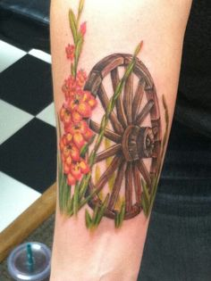 My sisters tattoo. Wagon wheel for Grandpa A. and glads for Grandpa C.