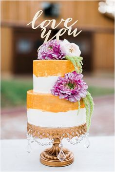 Gold and pink wedding cake by Rustic White Photography