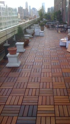 SwiftDeck Colorado tiles on a long roof deck Wood Deck Tiles, Terrace Tiles, Rooftop Deck, Rooftop Garden, Easy Deck, Brick Siding, Modern Deck, Floating Deck, Enclosed Patio