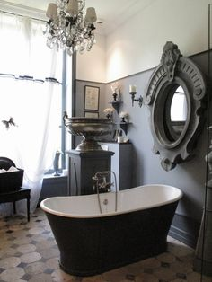 "Grey wall color to match the tub!  "" I personally do not care for the over proportional Mirror and urn but the gray painted tub is a classic!"""