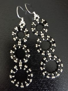 Beaded earrings. Half tilas and seed beads. Inspiration from a Monica Lopez tutorial at Caravan Beads bead blog.