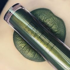 """Lip swatch of @five11_cosmetics liquid to matte lipstick in the shade """"BRILLIANT"""" Such a gorgeous olive green with gold shimmer!! Very unique shade  ⬇REVIEW TIME⬇ First of all I love the doe applicator, It is thin and kind of flat and very soft. It really helps you get an even application! The packaging is cute and simple, and the lipsticks have a mild vanilla scent not strong but barely there.  They're Cruelty free ($15) each  About the formula: The consistency on these Liquid to matte..."""
