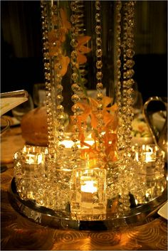 Glowing crystal centerpiece. The candles reflect the crystals making them sparkle and shine! #weddingcenterpiecehire #wedding #hire #orange #centerpiece #centerpiece #crystals #hire #melbourne #floralcenterpieces #floralcenterpiecesmelbourne #floralstyling #flowercenterpieces #flowersforweddings #tabledecorations #weddingcenterpiecesmelbourne #weddingdecorhire #weddingdecorationideas #weddingdesign www.decorit.com.au (20)
