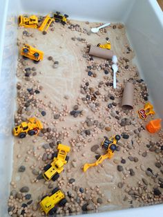 Construction themed activities . Transport. Sand tray. Rocks. Pebbles. Stones. Bob toys. Diggers